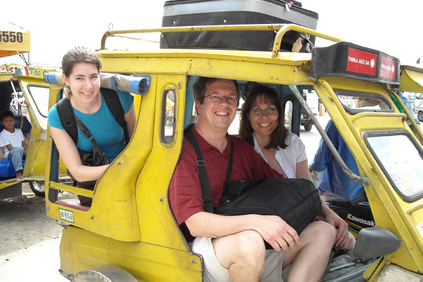 "David, Cathy and Betsy being transported by ""trike"""